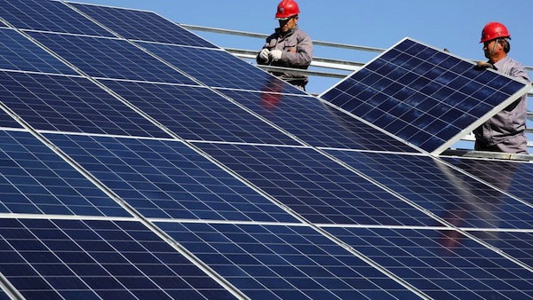 Workers-install-solar-panels